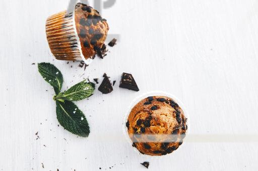 Two home-baked muffins with chocolate chips