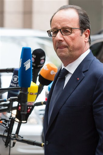 French President Francois Hollande talks with journalists as he arrives for an EU summit in Brussels on Saturday, Aug. 30, 2014. At a summit on Saturday EU leaders will discuss who will get the job as the 28-nation bloc's foreign policy chief for the next 5 years and the situation in Ukraine. (AP Photo/Virginia Mayo)