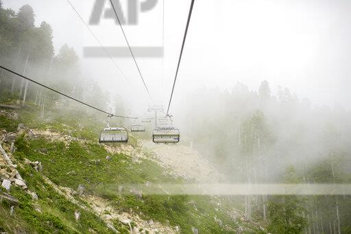 Russia, Sochi, empty cable railway in cloudy forest