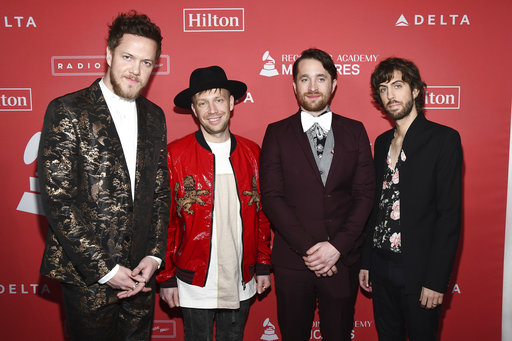 Imagine dragons maroon 5 to perform during march madne file in this jan 26 2018 file photo dan reynolds from left ben mckee daniel platzman and daniel wayne sermon of imagine dragons arrives at the 2018 m4hsunfo