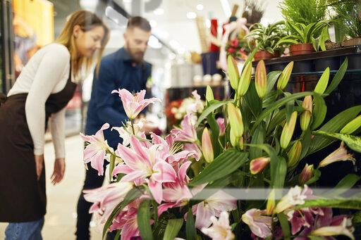 Custumer and shop assistant in flower shop