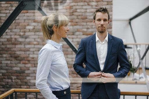 Businesswoman looking admiring at colleague
