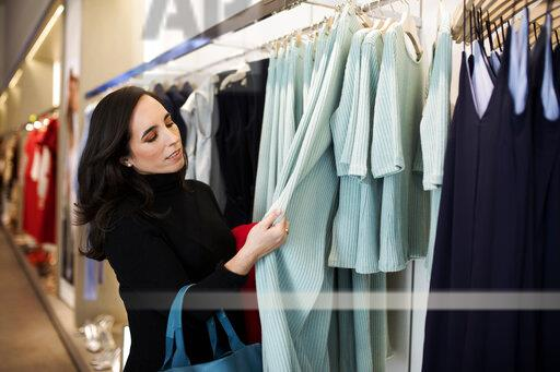 Woman shopping for clothes in a boutique