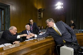 Carl Levin, John McCain, J. Richard Harvey