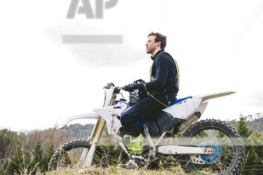 Portrait of motocross driver on circuit