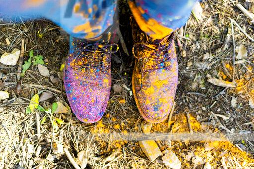 Shoes of a person covred in powderb paint, celebrating Holi, Festival of colors