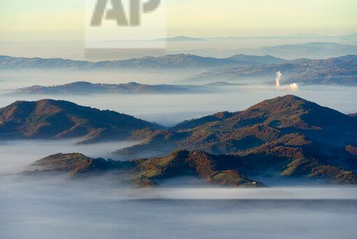 Italy, Umbria, Apennines at sunrise seen from mount Cucco