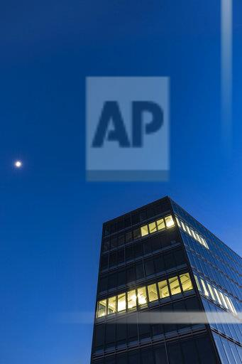 Germany, Stuttgart, lighted windows at modern office building at blue hour