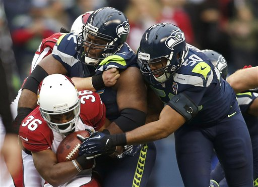 Brandon Mebane, K.J. Wright, LaRod Stephens-Howling