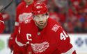In this Jan. 20, 2018 photo, Detroit Red Wings' Henrik Zetterberg plays against the Carolina Hurricanes in the first period of an NHL hockey game in Detroit. A degenerative back issue is causing the 37-year-old Zetterberg to stop playing it after it was announced Friday, Sept. 14, 2018, at training camp. Zetterberg is not going to officially retire, of course; that would mean forfeiting the remaining $5.35M owed to him through the 2020-21 season. (AP Photo/Paul Sancya)