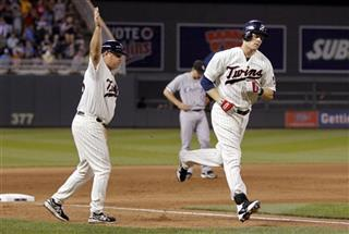 Justin Morneau, Joe Vavra