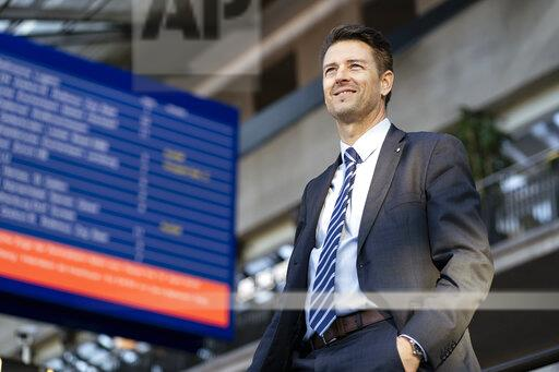 Smiling businessman at the station