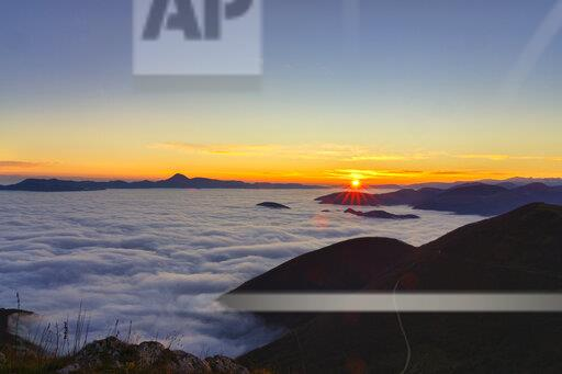 Italy, Marche, Apennines, Mount San Vicino at sunrise seen from mount Cucco