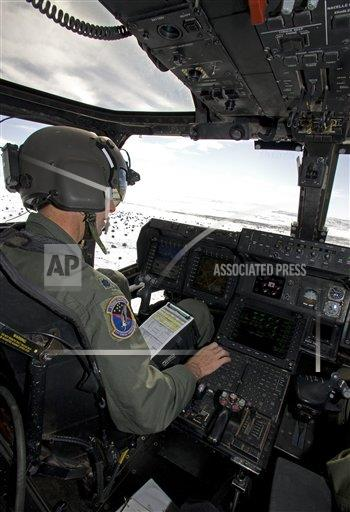Creative AP Photo/Stocktrek Images A Military New Mexico USA vertical Pilot of a CV-22 Osprey goes over his instruments in the cockpit.