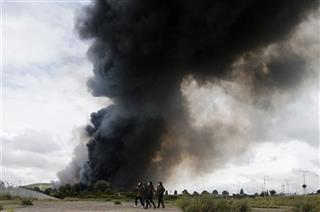 APTOPIX Spain Tyre Dump Fire