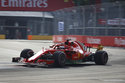 Ferrari driver Sebastian Vettel of Germany steers his car during first practice at the Marina Bay City Circuit ahead of the Singapore Formula One Grand Prix in Singapore, Friday, Sept. 14, 2018. (AP Photo/Vincent Thian)