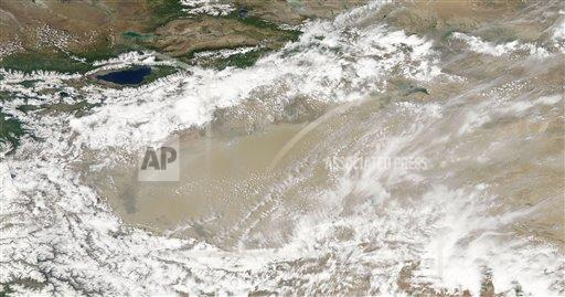 Creative AP T    horizontal Dust and clouds hovered over the Taklimakan Desert.
