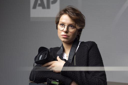 Portrait of young photographer with camera