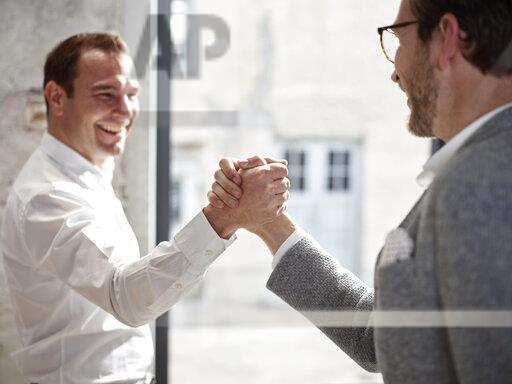 Two happy businessmen shaking hands