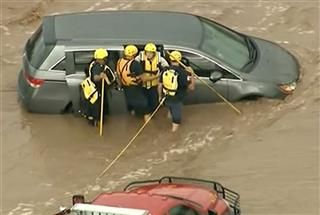Vehicle in Flooded Wash