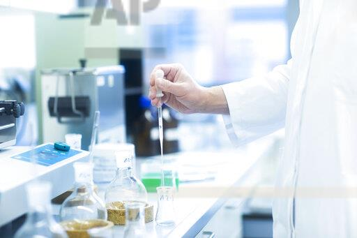 Lab technician experimenting in lab