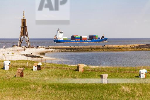 Germany, Lower Saxony, Cuxhaven, North Sea, Ball beacon at beach, hooded beach chairs, container ship