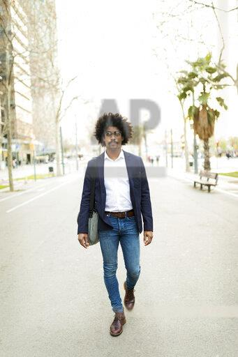 Spain, Barcelona, businessman on the move in the city