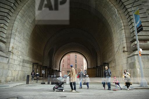 Families are seen walking beneath the Dumbo Archway in Brooklyn, New York