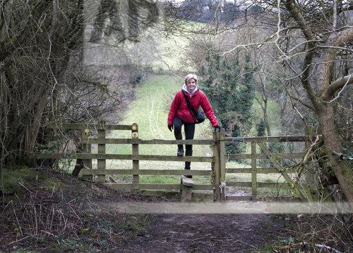 UK, Gloucester, Chipping Sodbury, Cotswold Way, woman on a hiking trip crossing pasture fence