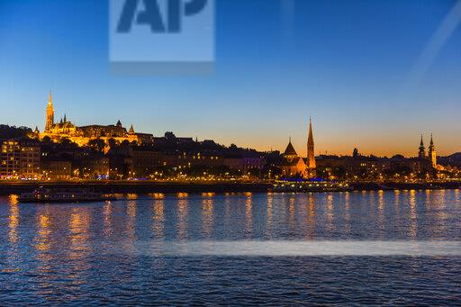 Hungary, Budapest, city view with Matthias Church at dusk