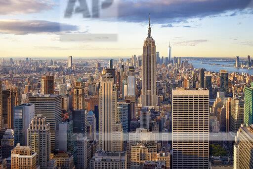 Lower and Midtown Manhattan skyline at sunrise, New York City, New York, United States