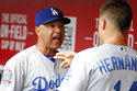 Los Angeles Dodgers manager Dave Roberts, left, speaks with Los Angeles Dodgers center fielder Enrique Hernandez, right, in the dugout during the fifth inning of a baseball game against the Cincinnati Reds, Wednesday, Sept. 12, 2018, in Cincinnati. (AP Photo/John Minchillo)