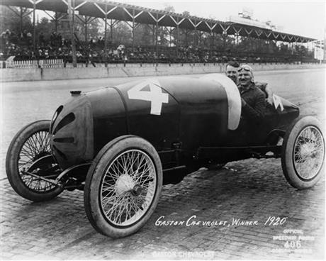 this May 30, 1913, file photo, spectators watch the Indianapolis 500 ...