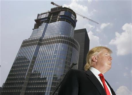 Donald Trump is profiled against his 92-story Trump International Hotel & Tower during a news conference on construction progress in Chicago.