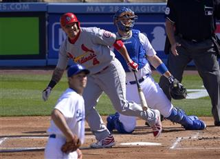 Yadier Molina, A.J. Ellis, Ted Lilly