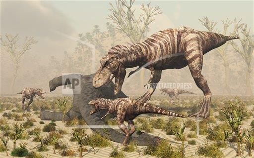 Creative AP T Prehistoric Era   horizontal A family of T. Rex dinosaurs feed on the carcass of a sauropod.