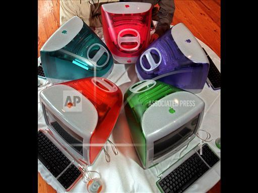 Apple iMac computers in five colors: strawberry, blueberry, grape, tangerine and lime, photo on black