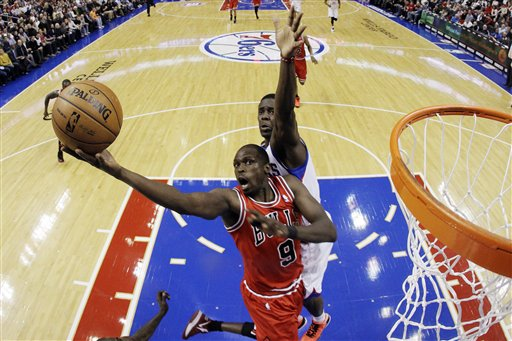 Jrue Holiday, Luol Deng
