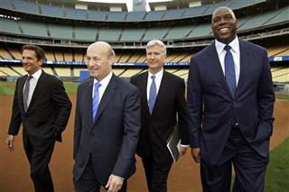 Peter Guber, Stan Kasten, Mark Walter,  Magic Johnson