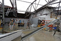 Ethan Hall, right, Michael Jenkins, center, and Nash Fralick, left, examine damage to Tidewater Brewing Co. in Wilmington, N.C., after Hurricane Florence made landfall Friday, Sept. 14, 2018. (AP Photo/Chuck Burton)