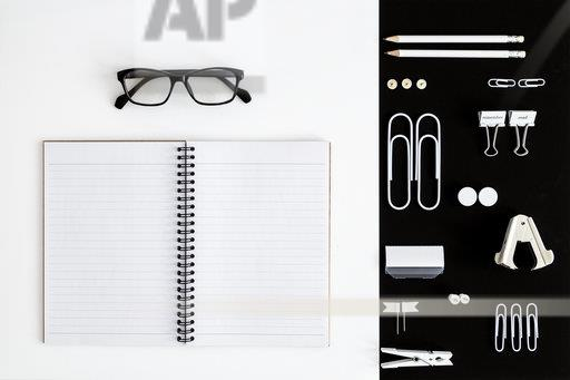 White office utensils on black background and notepad and glasses on whilte background