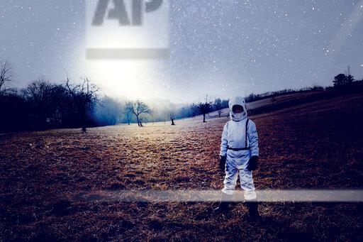 Boy wearing white space suit, starry sky