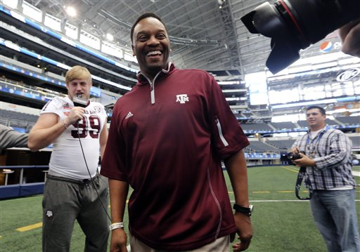 Kevin Sumlin,  Spencer Nealy