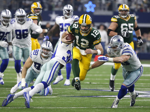 Anthony Brown, Sean Lee, Aaron Rodgers