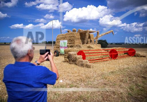 Straw combine advertises village festival