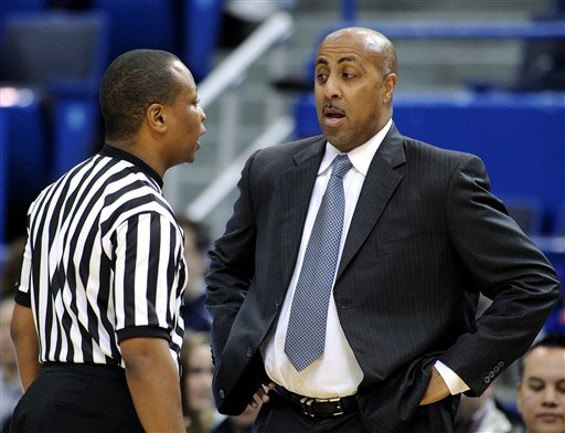 Lorenzo Romar, woman official