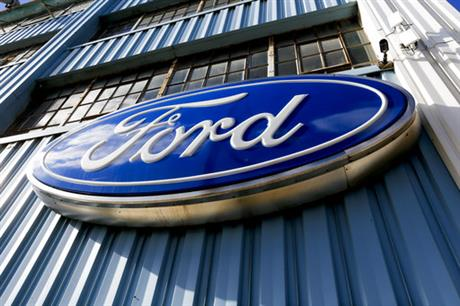 Ford sign above the entrance to Butler County Ford in Butler, Pa. Ford ...