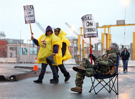 Port worker's 24-hour strike