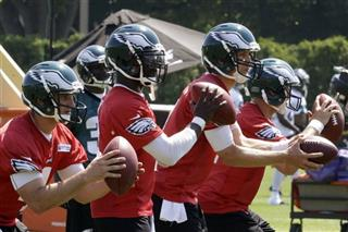 G.J. Kinne, left, Michael Vick, Connor Barwin, Matt Barkley
