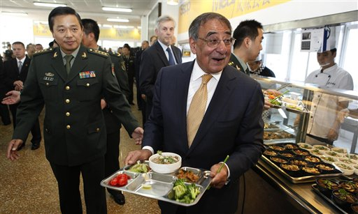 U.S. Secretary of Defense Leon Panetta walks with his lunch at PLA military academy in Beijing